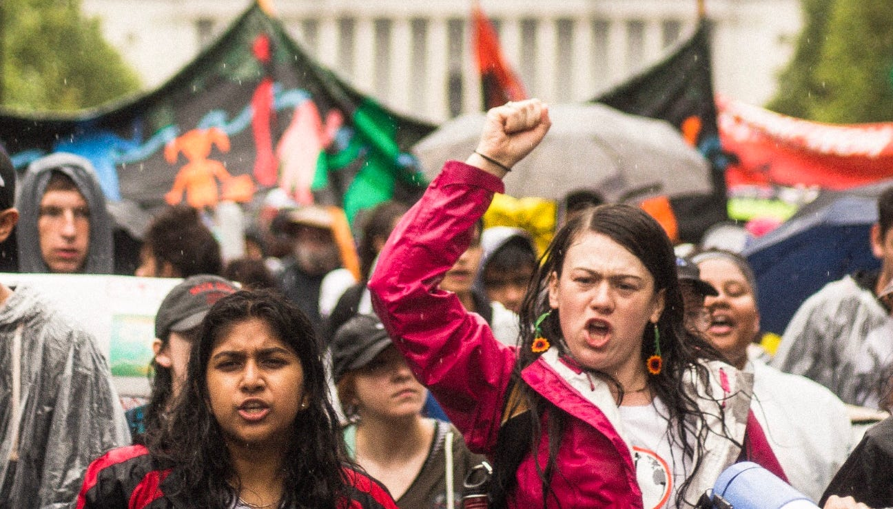Nadia Nazar and Iris Fen lead a group of young people marching on Capitol Hill in July.