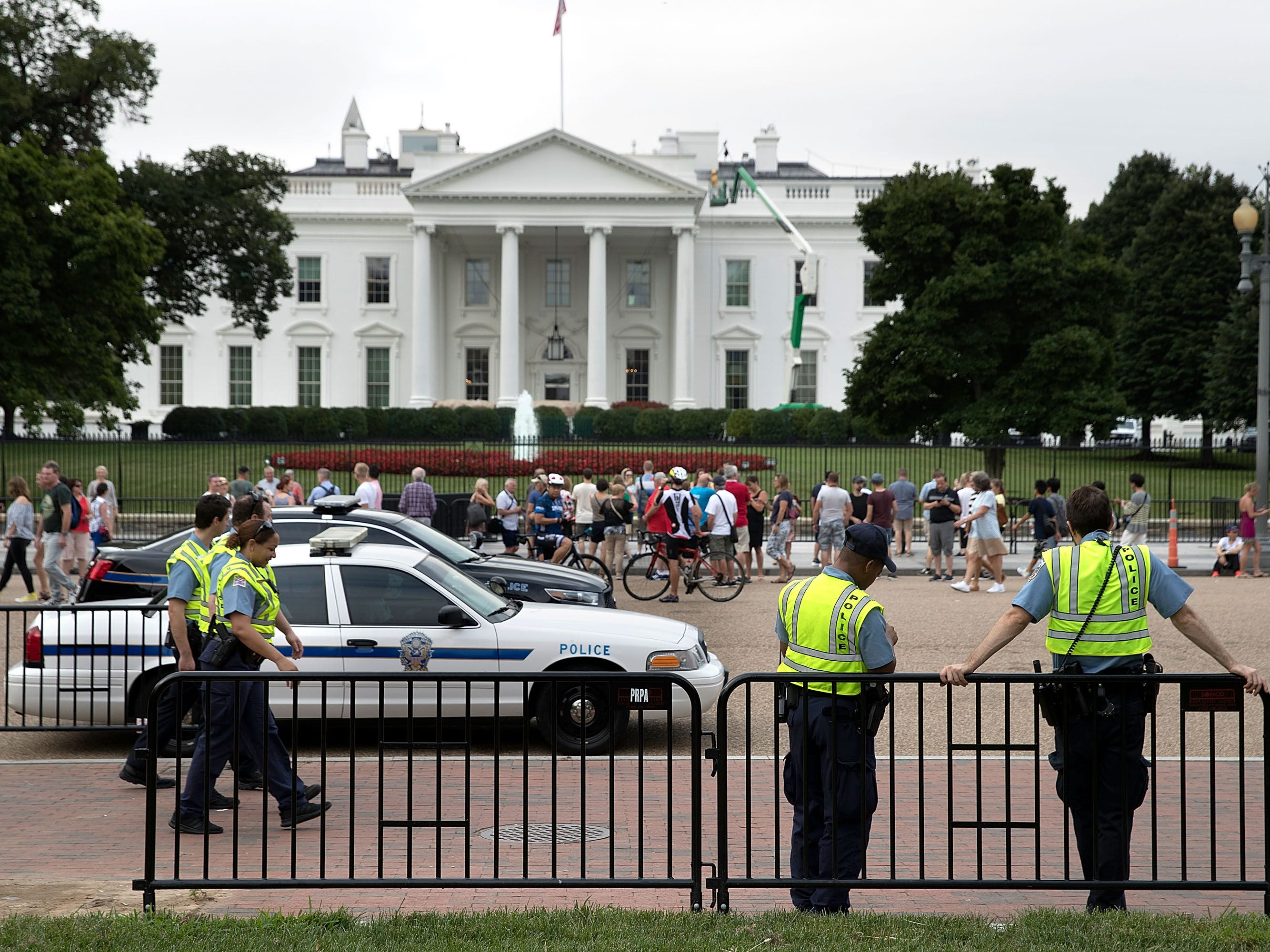 Police gather in front of the White House ahead of the planned white supremacists Unite the Right rally in Lafayette Park Aug. 12, 2018 in Washington, DC.