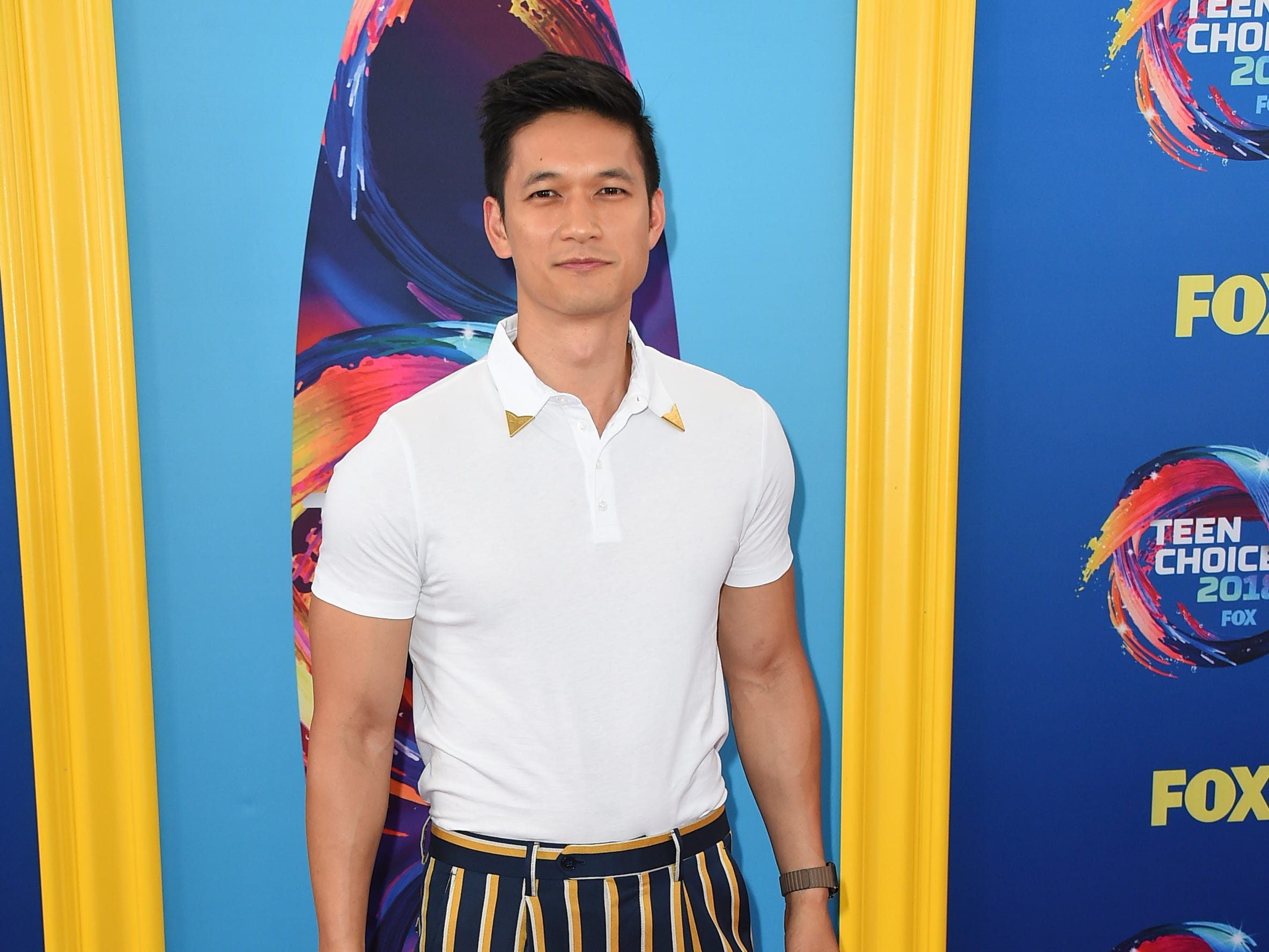Harry Shum Jr. arrives at the Teen Choice Awards at The Forum on Sunday, Aug. 12, 2018, in Inglewood, Calif. (Photo by Jordan Strauss/Invision/AP) ORG XMIT: CAPM101