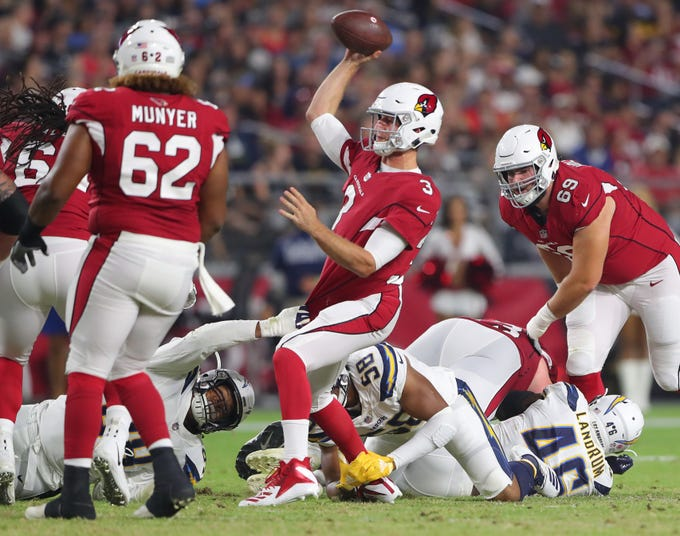 Arizona Cardinals quarterback Josh Rosen (3) throws a pass under pressure by the Los Angeles Chargers during a preseason game at University of Phoenix Stadium.
