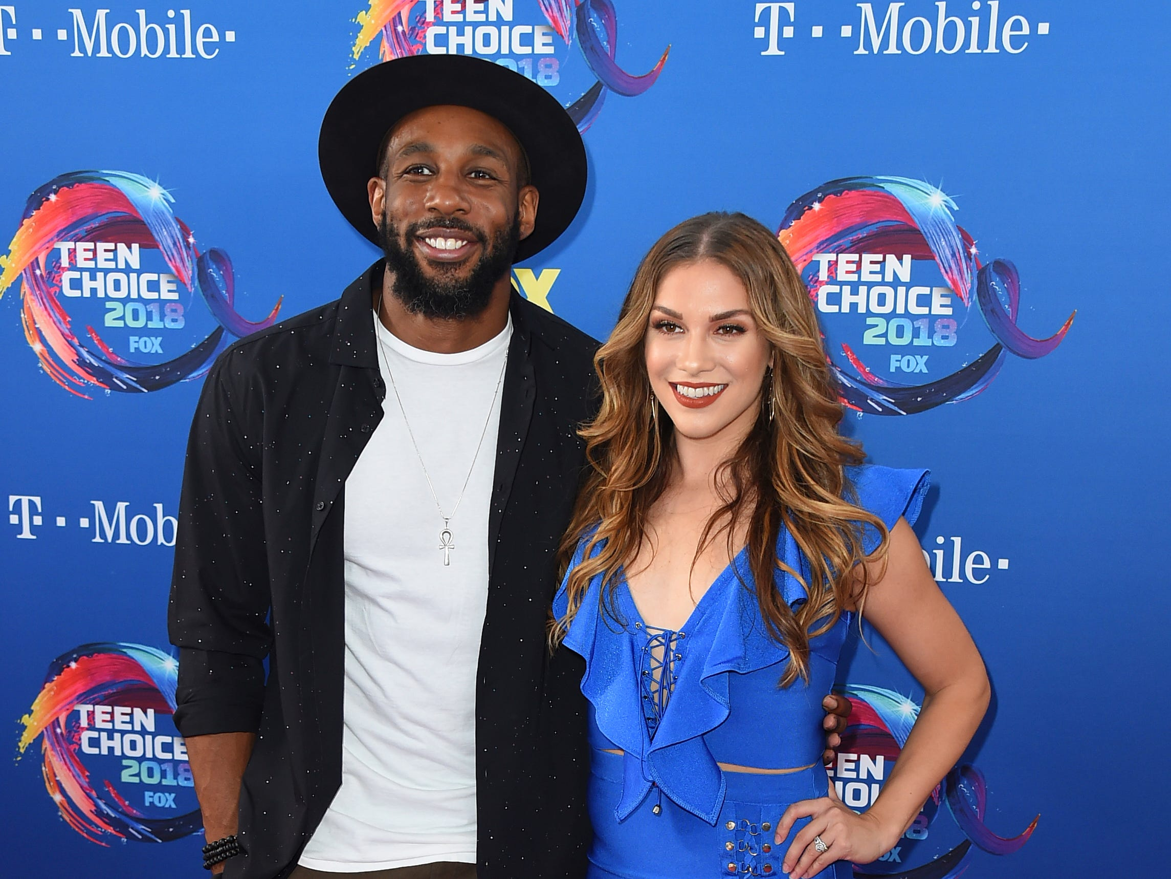 "Stephen ""tWitch"" Boss, left, and Allison Holker arrive at the Teen Choice Awards at The Forum on Sunday, Aug. 12, 2018, in Inglewood, Calif. (Photo by Jordan Strauss/Invision/AP) ORG XMIT: CAPM126"