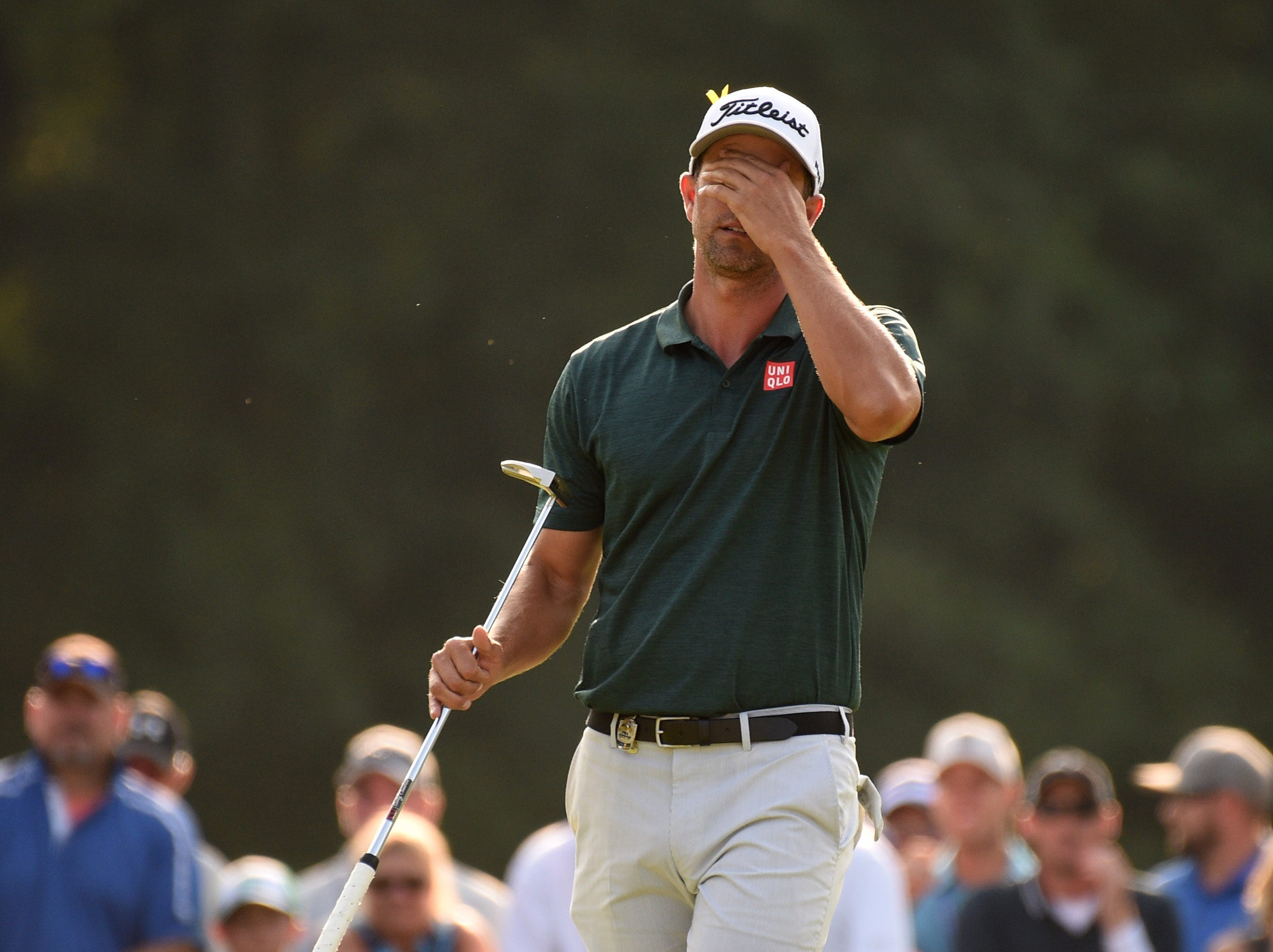 Adam Scott reacts after missing a putt on the 18th green during the third round of the PGA Championship. He's in second, two shots back.