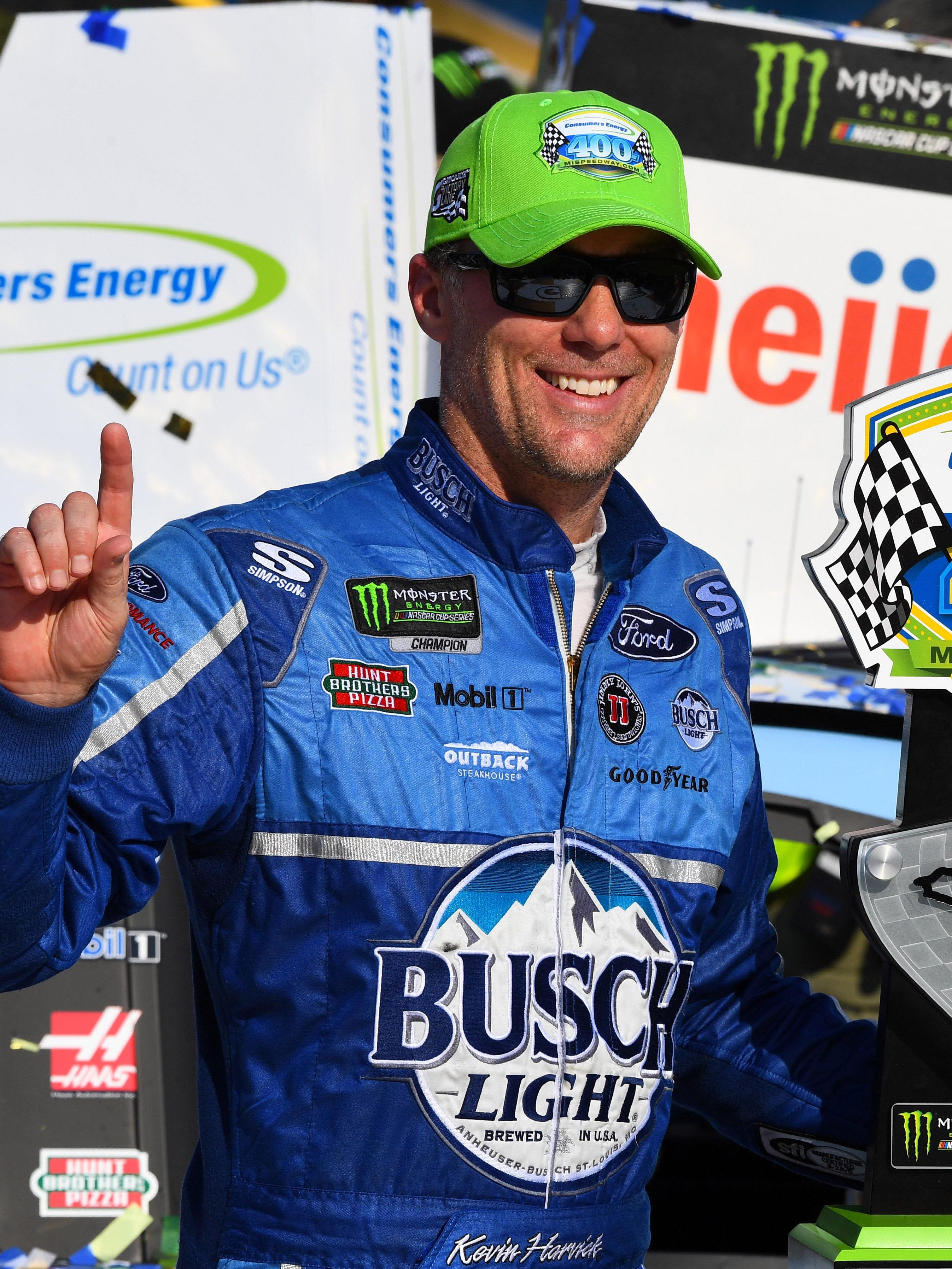 Kevin Harvick celebrates after winning the Consumers Energy 400 Sunday at Michigan International Speedway.