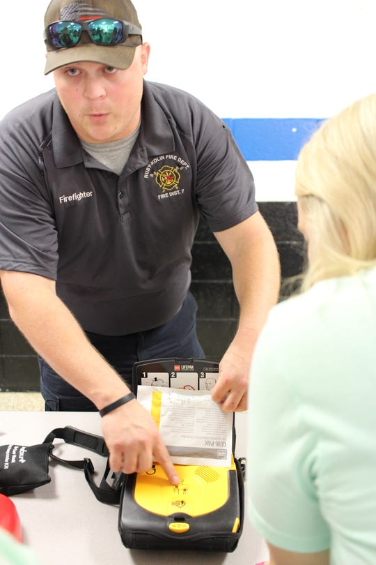 Ruby-Kolin firefighter Mitchell Schumacher describes how Ruby-Wise Elementary School's AED (automated external defibrillator) works for teachers and staff during training on Monday.