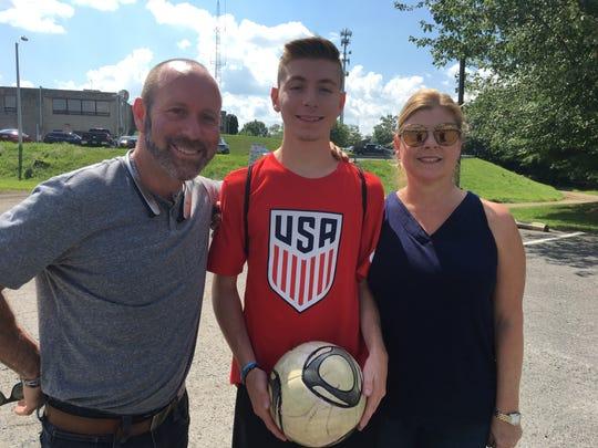 Jake Kaplan, center, with parents Adam and Hollie Kaplan.