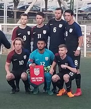 Marlboro's Jake Kaplan, bottom right, poses with U.S. Paralympic Soccer teammates after winning the silver medal in Barcelona earlier this summer.