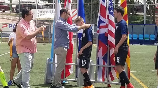 Marlboro's Jake Kaplan receives a silver medal along with U.S. Paralympic Soccer teammates in Barcelona earlier this summer.
