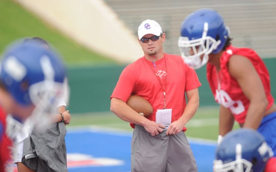 First-year Cooper coach Aaron Roan watches as his Cougars began fall practice Monday. Aug. 13, 2018 at Shotwell Stadium. Roan took over for Todd Moebes on July 9, after Moebes resigned.
