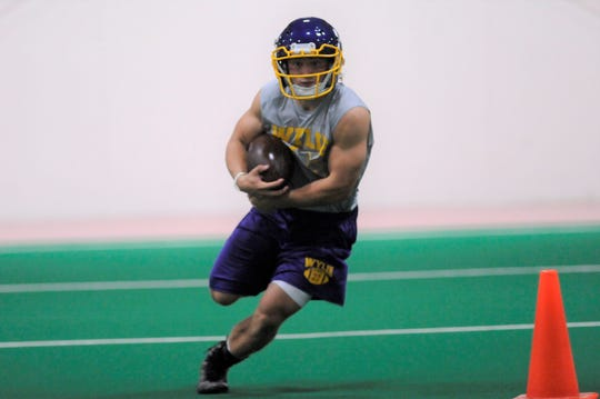 Wylie tailback Bailey Hicks turns upfield after taking a handoff during the first fall practice at the Doghouse on Monday, Aug. 13, 2018.