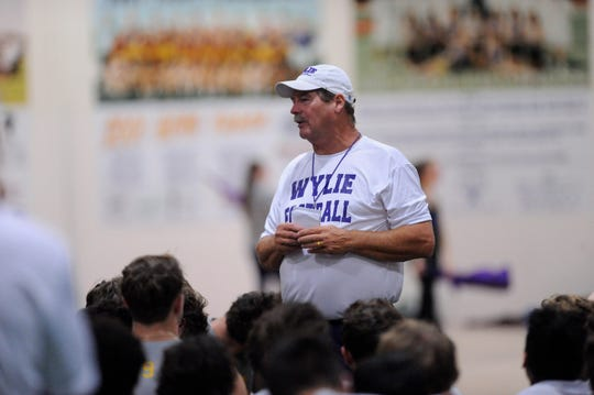Abilene Reporter News                          Wylie coach Hugh Sandifer talks to the team after the first fall practice at the Doghouse on Monday, Aug. 13, 2018. This is the 33rd fall camp for Sandifer at Wylie. He is the fifth among active coaches with 283 career wins (283-109-4).