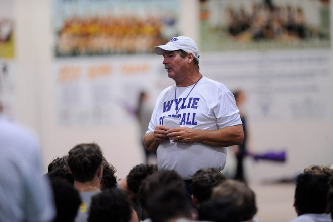 Wylie coach Hugh Sandifer talks to the team after the first fall practice at the Doghouse on Aug. 13. This is the 33rd fall camp for Sandifer at Wylie.