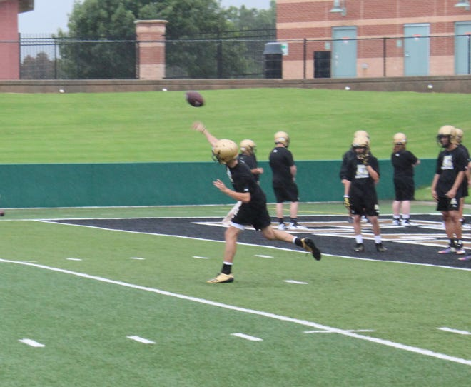 The 2018 Abilene Eagle football team runs through seven on zero drills Aug. 13.