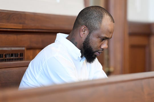 Marcus Hyatt waits in a courtroom at the Buncombe County Courthouse for a hearing about the release of police body camera footage from the January day he was detained and strip searched by Buncombe County Sheriff deputies on Monday, Aug. 13, 2018. The footage was released to him and his attorney.