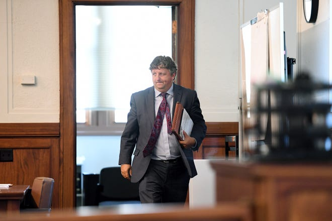 John Sutton, Marcus Hyatt's attorney, leaves Buncombe County courtroom after a hearing regarding the release of body camera footage from the January day Hyatt was detained and strip searched by Buncombe County Sheriff deputies on Monday, Aug. 13, 2018. The footage was released.