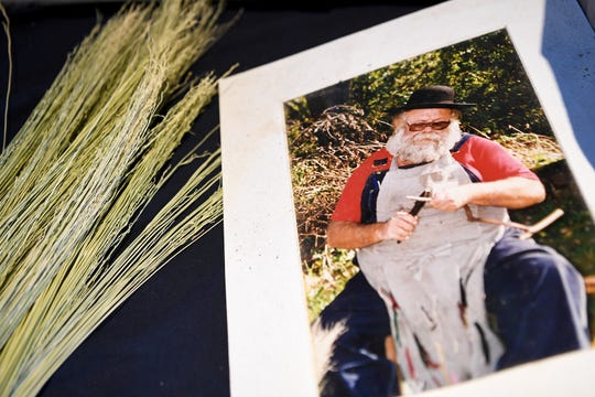 A photo shows Marlow's father, Ralph Gates, crafting a broom. Ralph Gates was once a NASA scientist who quit his job to move to the mountains and become a broom maker.