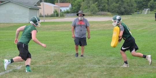 New Pennfield head football coach Mike Clothier watches a drill during preseason practice.