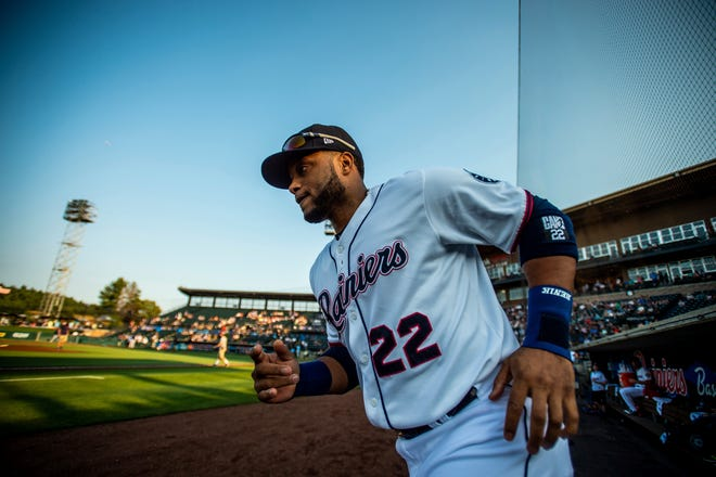 Robinson Cano runs onto the field at Cheney Stadium during his first rehab start with the Rainiers on Aug. 6. Cano is eligible to return to the Mariners' lineup on Tuesday.