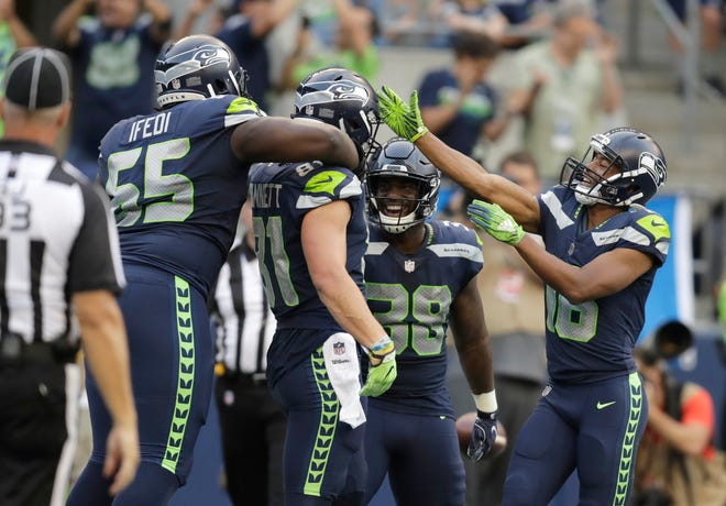 Seahawks tight end Nick Vannett, second from left, celebrates his touchdown during Thursday's preseason game against the Colts. Joining him were teammates, from left, Germain Ifedi, Tre Madden and Tyler Lockett.