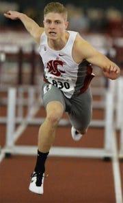 CJ Allen runs the hurdles while at Washington State University.