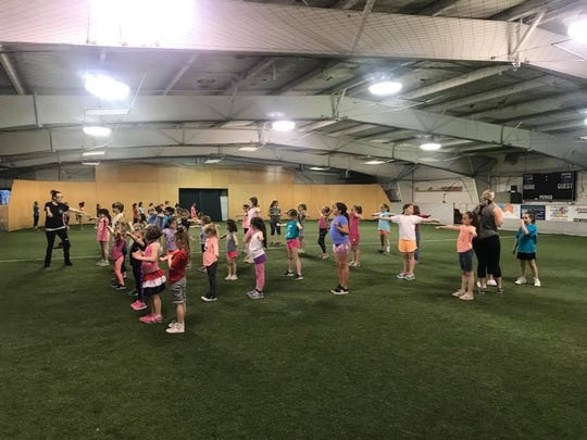 Cheerleaders with the Warhorse Youth Football and Cheer league prepare for the upcoming Stampede in the Valley on Aug. 23 at Warhorse Stadium.