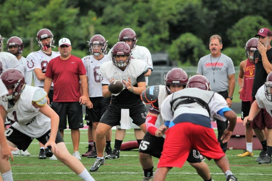 Owen sophomore Caleb Scott takes a snap at quarterback during practice. Scott has been splitting time at the position with senior Audun Meyers (6) as the Warhorses get ready to start the season.