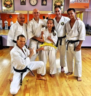 Holly Hammac, 11, who Cerebral Palsy,  was promoted to the rank of yellow belt at an event this past weekend.