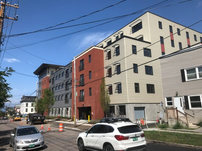 From Maple Street, looking northwest: Light traffic passes beside the nearly complete 194 St. Paul Street apartments on Monday, Aug. 13, 2018.