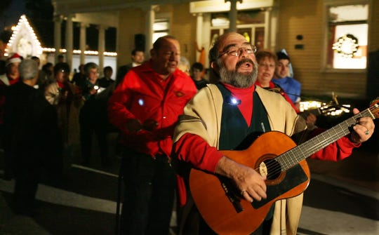 Leo Carrillo (front) leads the singing at the fourth annual Amigos de Mexico Posada at Heritage Park on Friday. The event included singing, Scripture readings and a party complete with a piñata for children on December 15, 2006.