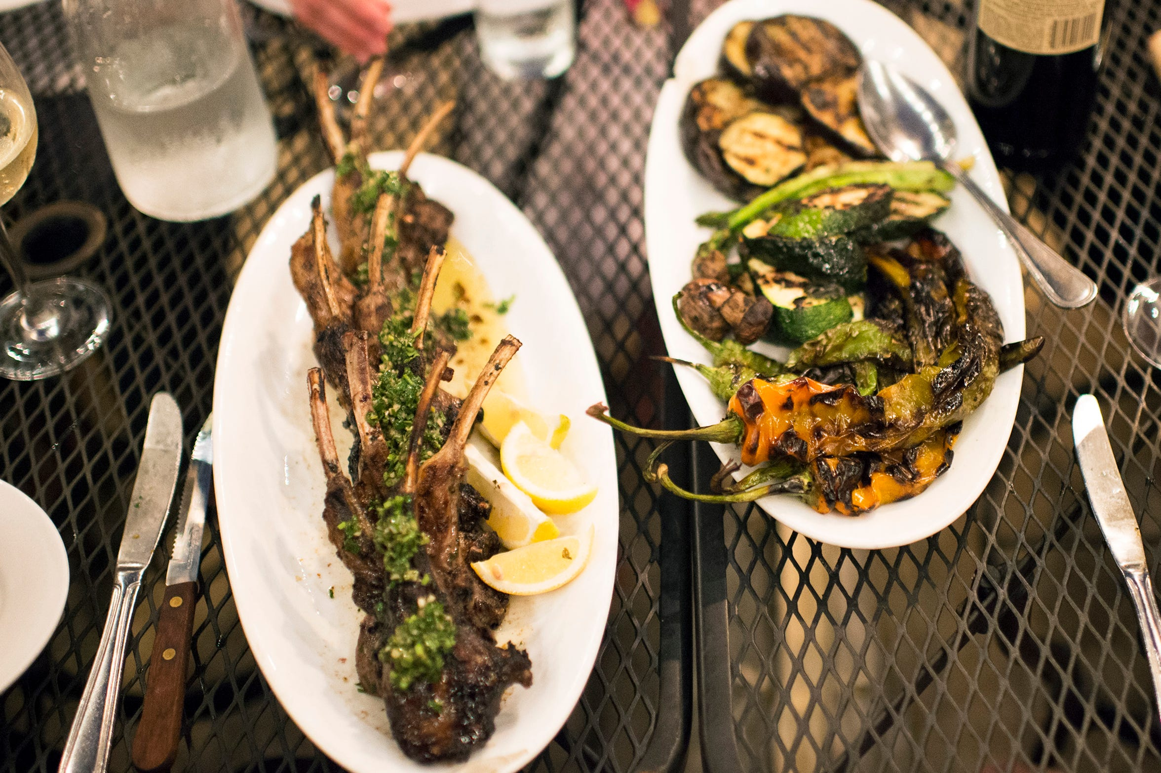 Grilled lamb chops are placed beside a plate of grilled vegetables for a special Sicilian style barbecue at Zeppoli in Collingswood.