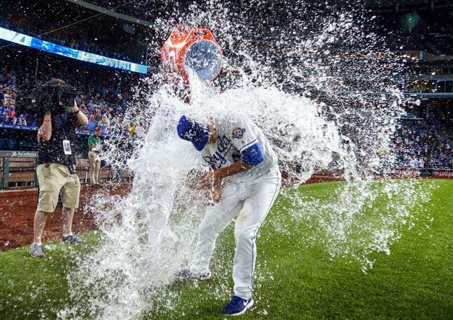 Kansas City Royals starting pitcher Heath Fillmyer (49) is doused by designated hitter Salvador Perez (13) after defeating the Chicago Cubs at Kauffman Stadium. It was the first MLB win for the Florence native. Mandatory Credit: Jay Biggerstaff-USA TODAY Sports