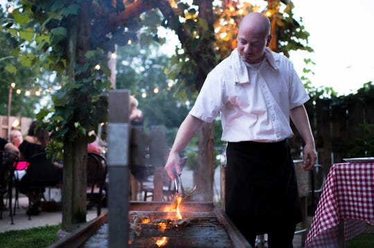 Chef Joey Baldino grills lamb chops for a Sicilian style barbecue at Zeppoli in Collingswood, N.J