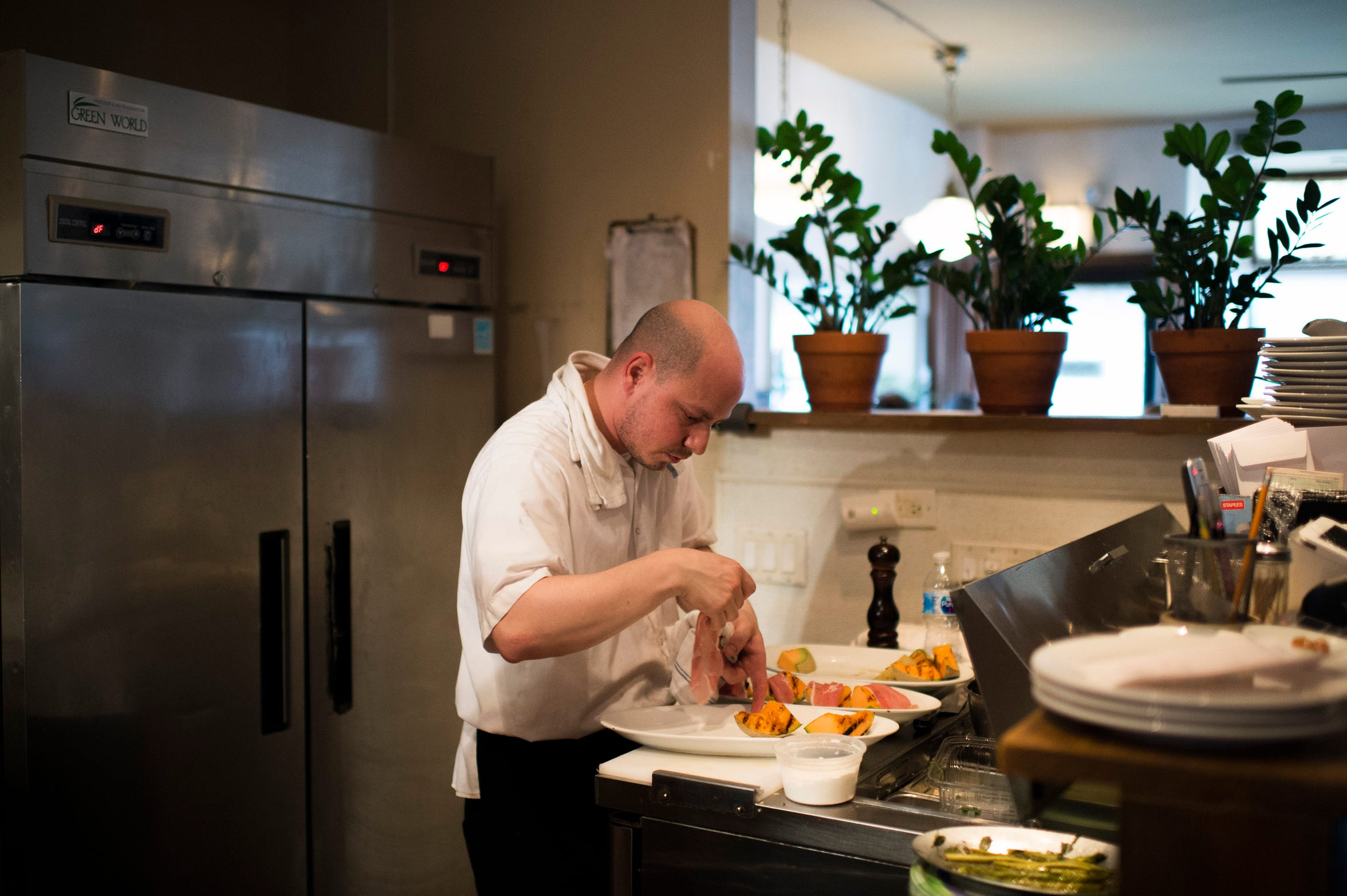 Chef Joey Baldino prepares a dish inside the Zeppoli kitchen in Collingswood. Baldino also owns Palizzi Social Club, a private club in South Philly.