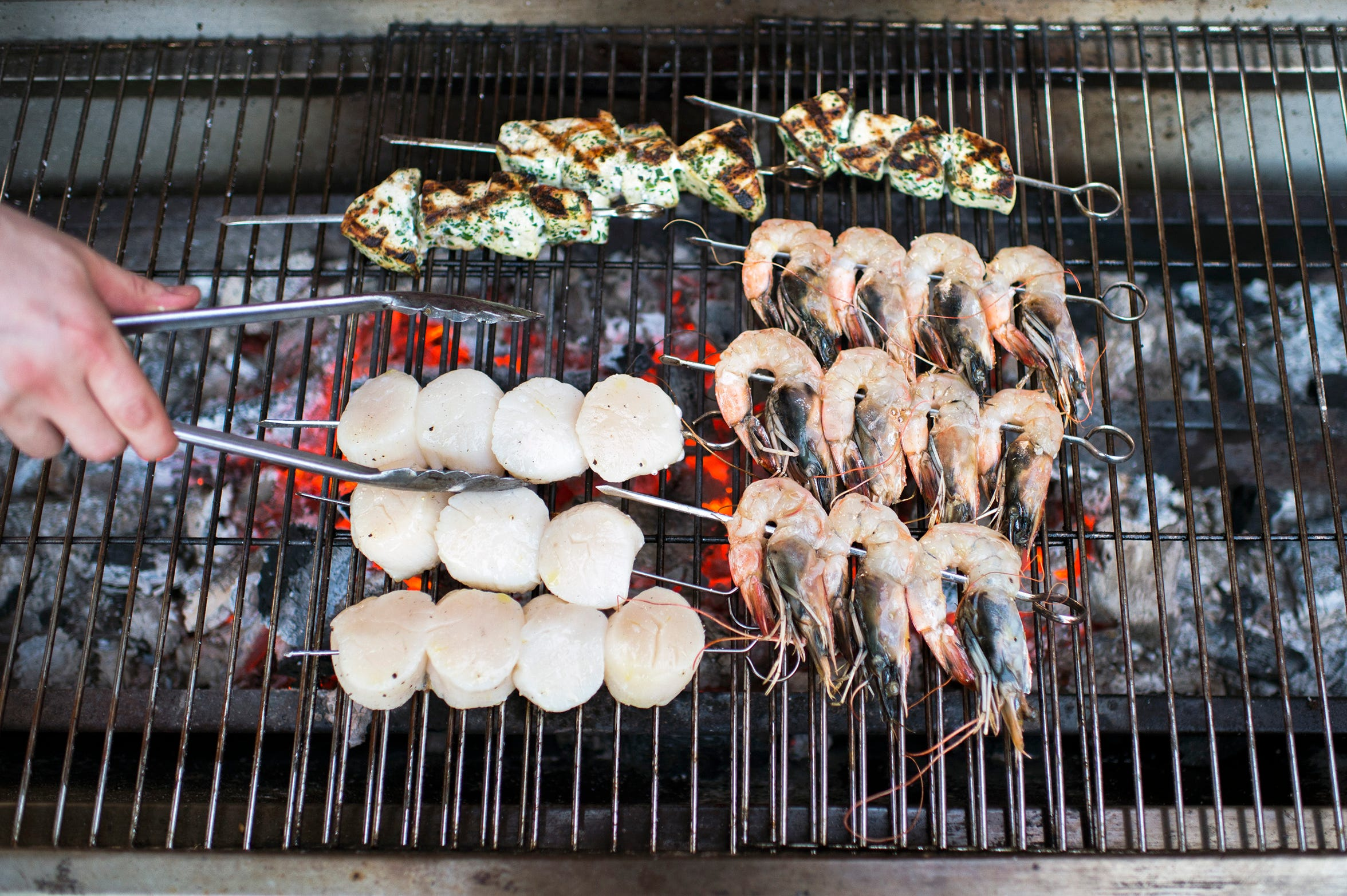 Chef Joey Baldino grills scallops, shrimp and fish skewers for a special Sicilian-style barbecue at Zeppoli in Collingswood.