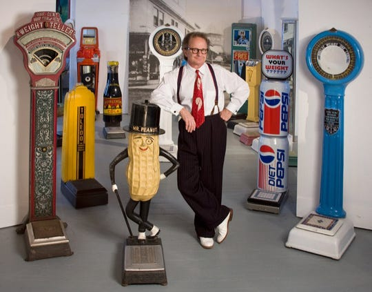 """Christopher K. Steele of Columbus stands with his collection of Art Deco penny scales. Dr. Ruth K. Meyer, former director, The Taft Museum of Art, will use these as examples in her speech about """"The American Weigh"""" on Nov. 4."""