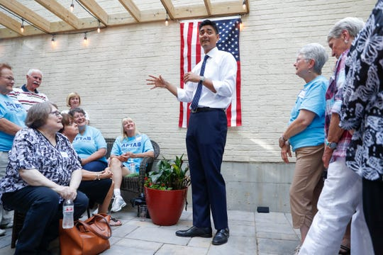 Hamilton County Clerk of Courts Aftab Pureval speaks at a fundraising event for his 1st House District campaign challenge to veteran Republican Rep. Steve Chabot at a supporters home, Friday, June 15, 2018, in Maineville, Ohio.