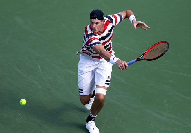 John Isner returns a serve from Sam Querrey during the first round of the Western and Southern Open on Center Court at the Lindner Family Tennis Center in Mason Monday, August 13, 2018.