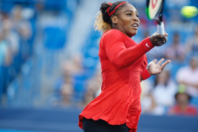 Williams returns with a forehand against Gavrilova.
