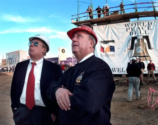 Verdin Bell president Jim Verdin, left, and Wayne Carlisle, president and CEO of the Millenium Monument Co. watch in 1999 as the World Peace Bell is installed at the Pavilion at Fourth and York streets in Newport. The bell, suspended in the new tower, rang in the new year and the new Millennium.