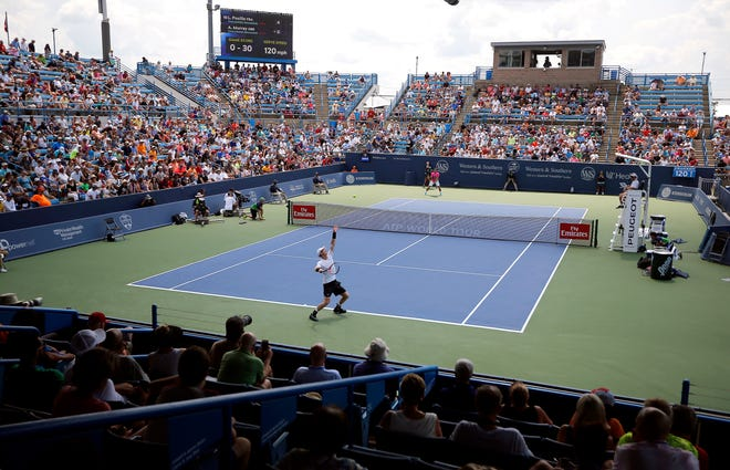 Andy Murray of Great Britain makes a serve to Lucas Pouille of France during the first round of the Western and Southern Open at the Lindner Family Tennis Center in Mason Monday, August 13, 2018. Murray lost  6-1, 1-6, 6-4.