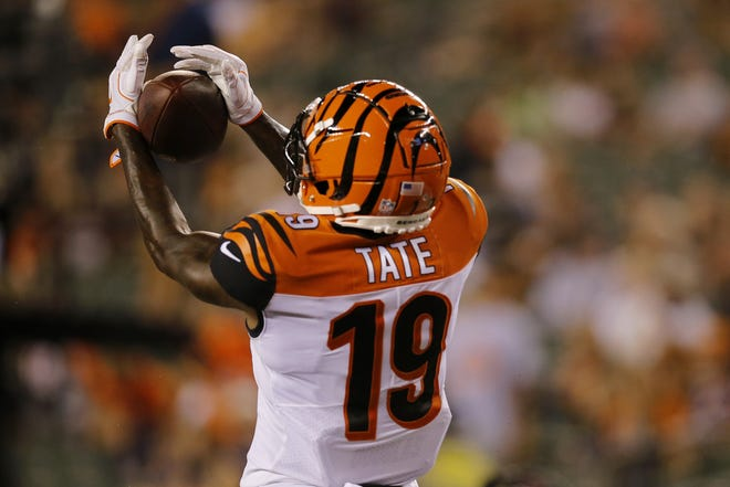Cincinnati Bengals wide receiver Auden Tate (19) makes a touchdown reception in the fourth quarter of the NFL Preseason Game One between the Cincinnati Bengals and the Chicago Bears at Paul Brown Stadium in downtown Cincinnati on Thursday, Aug. 9, 2018. The Bengals won the pre-season opener, 30-27.