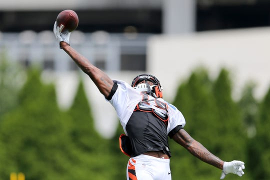 Cincinnati Bengals wide receiver Auden Tate (19) competes a one-handed catch in the end zone during Cincinnati Bengals training camp practice, Wednesday, Aug. 1, 2018, on the practice fields next to Paul Brown Stadium in Cincinnati.