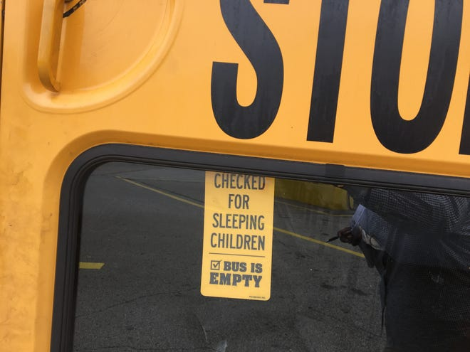 A First Student bus has reminders for drivers to keep students safe