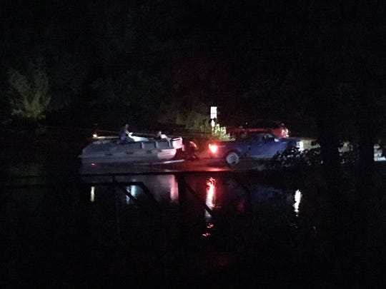 Crews search for missing boater near Mason's Boat Dock in Waverly, Tenn. Sunday, Aug. 12, 2018