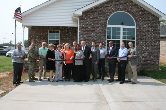 Clarksville Mayor Kim McMillan, Buffalo Valley Inc. CEO Jerry Risner, THDA Liaison Denise McBride and other dignitaries joined Monday to cut the ribbon on new affordable housing for veterans at Providence Pointe subdivision in Clarksville.