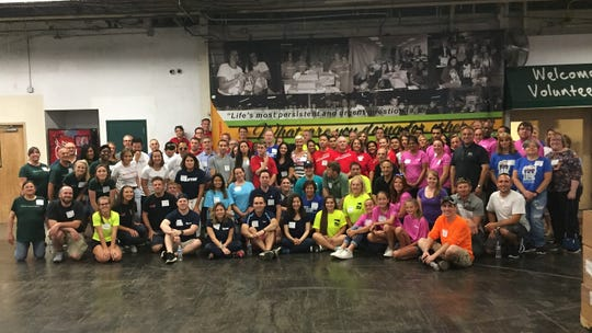 Representatives from 46 companies that are members of NAIOP collected more than two tons of food, plus money, for the Community Food Bank of New Jersey.