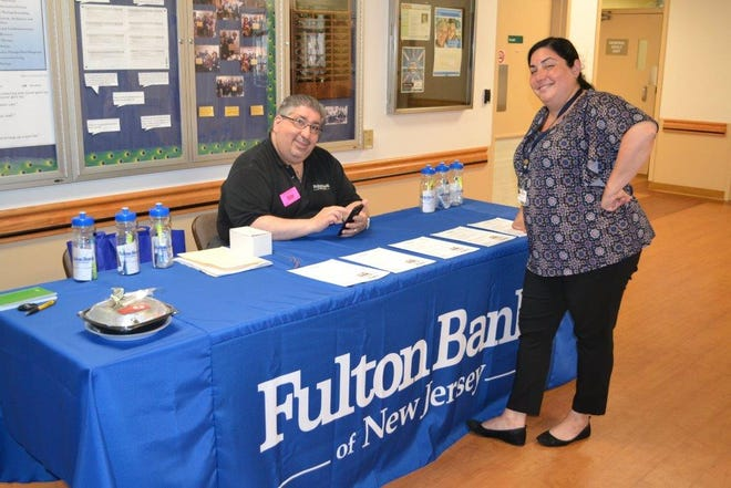 Hillsborough branch manager Paul Porto and his Fulton Bank team are annual supporters of Carrier Clinic and its Walk of Hope, helping to promote mental health and substance abuse services at New Jersey largest behavioral healthcare system.  Porto, a resident of Old Bridge, is seen providing information about Fulton banking services to Carrier Clinic employee Dina Calu, manager, quality and compliance, and a resident of Lawrenceville.