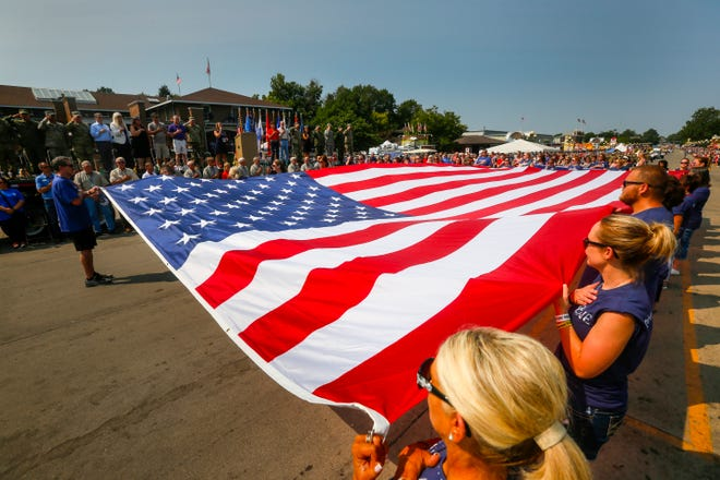 The National Anthem is played during the Veterans' Day Parade at the Iowa State Fair, Aug. 13, 2018.