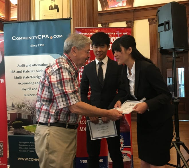 U.S. Ambassador to China Terry Branstad is shown handing out awards Monday, Aug. 13, 2018, at an Immigrant Entrepreneurs Summit in Des Moines, Iowa.