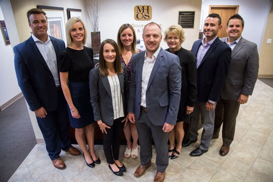 Marcus Benton, Staff Auditor, Ashley Sly, CPA, Manager, Jonathan Porter, CPA, Manager, Gina David, Marketing Director, Denise Hays, Administrative Assistant, Katelyn Fevold, CPA, Senior Accountant, Nick Finkenauer, CPA, Director, and David Farnsworth, CPA, Co-Managing Partner, at McGowen Hurst Clark & Smith, an accounting firm in West Des Moines, on Wednesday, Aug. 8, 2018.