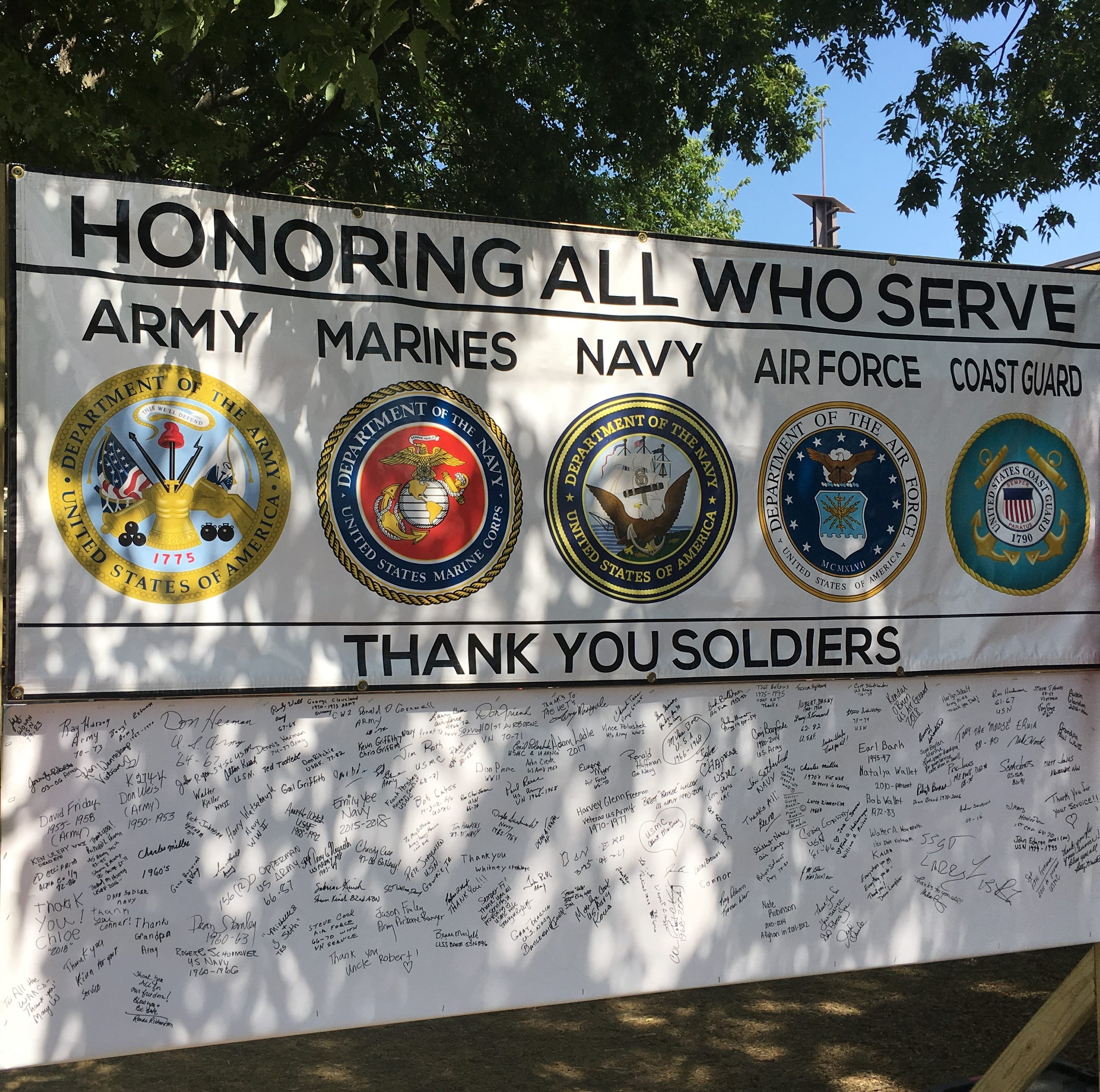 This sign was displayed Monday  at the Iowa State Fair to thank military veterans.  Members of the Iowa Democratic Party's veterans caucus said they were barred from marching as a group by an official representing Republican Gov. Kim Reynolds' administration, even though they have marched together in the past.
